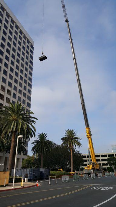 Crane removing rock